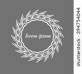 white frame of leaves on grey... | Shutterstock .eps vector #394754044