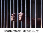 prisoner in jail | Shutterstock . vector #394818079