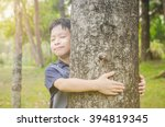 Young Asian Boy Hugging Tree I...
