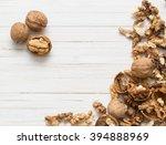 walnuts on white wooden... | Shutterstock . vector #394888969