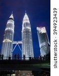 Small photo of KUALA LUMPUR,MALAYSIA - JULY 11, 2009: The Petronas Towers at night,Petronas Twin Towers are twin skyscrapers in Kuala Lumpur, Malaysia. Malaysia.Malaysia is a member of Asean Economic Community (AEC)