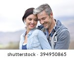 cheerful middle aged couple... | Shutterstock . vector #394950865