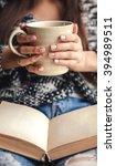 girl having a break with cup of ... | Shutterstock . vector #394989511