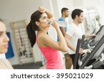 woman training and drinking... | Shutterstock . vector #395021029