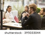 young businessman drinking... | Shutterstock . vector #395033044