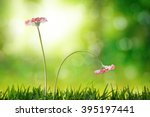 Small photo of Comparison emotional and social exclusion concept. With two flowers, upright and listless on nature background. Horizontal composition. Front view