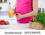 Pregnant Woman With Glass Of...