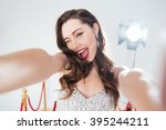 cheerful woman on red carpet... | Shutterstock . vector #395244211