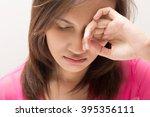 woman lying in bedroom... | Shutterstock . vector #395356111