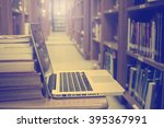 Small photo of note book open with books addle in library room,retro tone