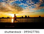 Silhouette of male runner at sunset along Hudson River on west side of Manhattan