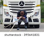 Small photo of Chemnitz, Germany - October 4, 2015: A strong man pulls a 15 ton heavy truck with a rope in the final of FIROCON Truck Pull European Championships.