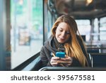 young woman using smartphone in ...   Shutterstock . vector #395675581