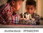 Black Toddler Blowing Candles...