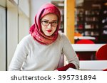 muslim woman at the library | Shutterstock . vector #395731894