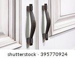 Stock photo door furniture handles and white door 395770924