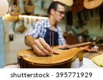 lute maker shop and classic... | Shutterstock . vector #395771929