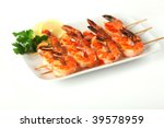 Shrimp skewers with sweet garlic chili sauce on white background - stock photo