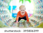 active toddler boy playing at... | Shutterstock . vector #395806399