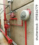 Small photo of water sprinkler and fire alarm system.