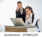two thoughtful businesswomen... | Shutterstock . vector #395881225