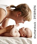 mother smiling to her baby | Shutterstock . vector #39589696