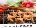 rouge chicken cooked on fire | Shutterstock . vector #395942557