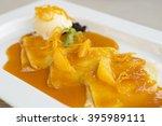 crepes with orange flavor sue... | Shutterstock . vector #395989111