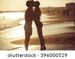 tender kiss loving couple at... | Shutterstock . vector #396000529