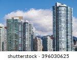 modern apartment buildings in... | Shutterstock . vector #396030625