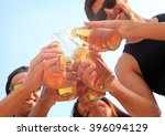 happy young friends drinking... | Shutterstock . vector #396094129
