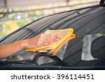 hand wipe cleaning the car... | Shutterstock . vector #396114451