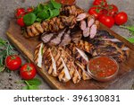 mixed grilled meat platter.... | Shutterstock . vector #396130831