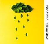 green leaves in shape of rainy... | Shutterstock . vector #396190051