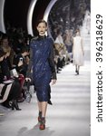 Small photo of PARIS, FRANCE - MARCH 04: A model walks the runway during the Christian Dior show as part of the Paris Fashion Week Womenswear F/W2016/17 on March 4, 2016 in Paris, France.