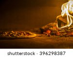 pizza in the oven | Shutterstock . vector #396298387