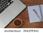 at the table with a cup of... | Shutterstock . vector #396299341