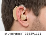 close up photo of ear with... | Shutterstock . vector #396391111
