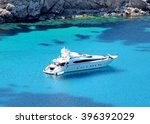 boat anchored in a bay  luxury... | Shutterstock . vector #396392029