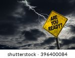 Small photo of Are You Ready sign against a stormy background with lightning and copy space. Dirty and angled sign adds to the drama.