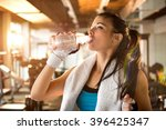 young athletic woman drinking... | Shutterstock . vector #396425347