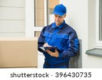 delivery man with cardboard... | Shutterstock . vector #396430735