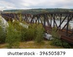 A multi span railway bridge over the Fraser River in British Columbia - stock photo