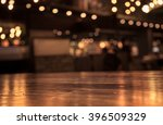 empty wood table top and  blur... | Shutterstock . vector #396509329