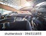 worker man open the car hood... | Shutterstock . vector #396511855