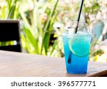 Ice Blue Lemon Soda On Wooden...