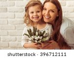 beautiful young mother and her... | Shutterstock . vector #396712111