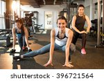 three pretty girls workout in... | Shutterstock . vector #396721564