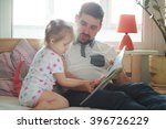 dad and daughter reading a book   Shutterstock . vector #396726229