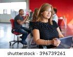 confident female designer... | Shutterstock . vector #396739261